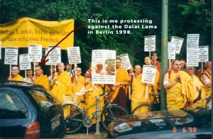 "This is me (Kelsang Tashi at that time) protesting against the Dalai Lama with the <a href=""http://info-buddhism.com/new_kadampa_tradition.html"" target=""_blank"">New Kadampa Tradition</a> under the front group <a href=""http://info-buddhism.com/dorje_shugden_controversy.html#The_Conflict_in_the_West"" target=""_blank"">Shugden Supporters Community</a> (SSC) in Berlin, Tempodrom, 6. August 1998. The Slogans were created by Kelsang Gyatso and state for instance ""Dorje Shugden loves Nyingmapas. Please don't lie."" or ""Dalai Lama please grand us religious freedom."""
