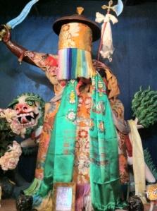 A statue of Shugden with the fierce face hidden