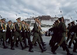 A patrol of the Chinese army in front of the Potala in Lhasa.