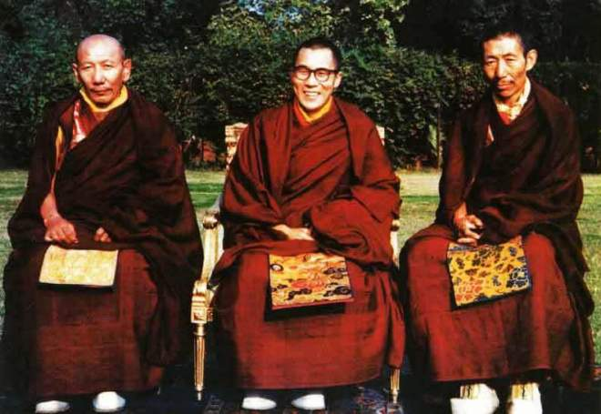 H.H. the Dalai Lama (middle) and his two main tutors. On the right side of H.H. the Dalai Lama sits Kyabje Ling Rinpoche, his senior tutor and on the left side sits Kyabje Trijang Rinpoche, his junior tutor.